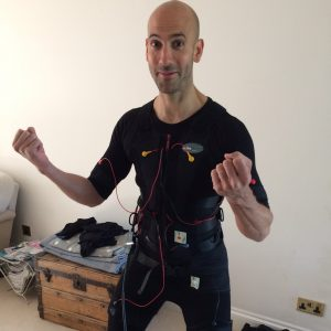 trainer tom in an ems suit