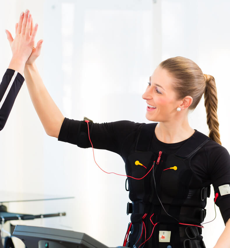 woman high-fiving ems personal trainer